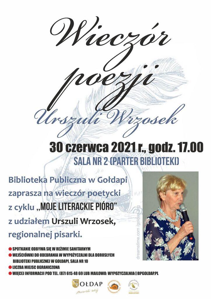 Biała kartka na której znajduje się pióro z dłonią oraz zdjęcie Urszuli Wrzosek.